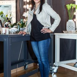 <b>Kate Gronso, Director of Beauty</b>, wearing Paige Denim jeans, a Black Swan leather jacket, J Crew camisole, Avant Garde necklace, Treisi druzy ring, Banana Republic tiger bangle, Natasha Grasso hammered gold bangle, Kamryn Dame gold bangle, and Micha