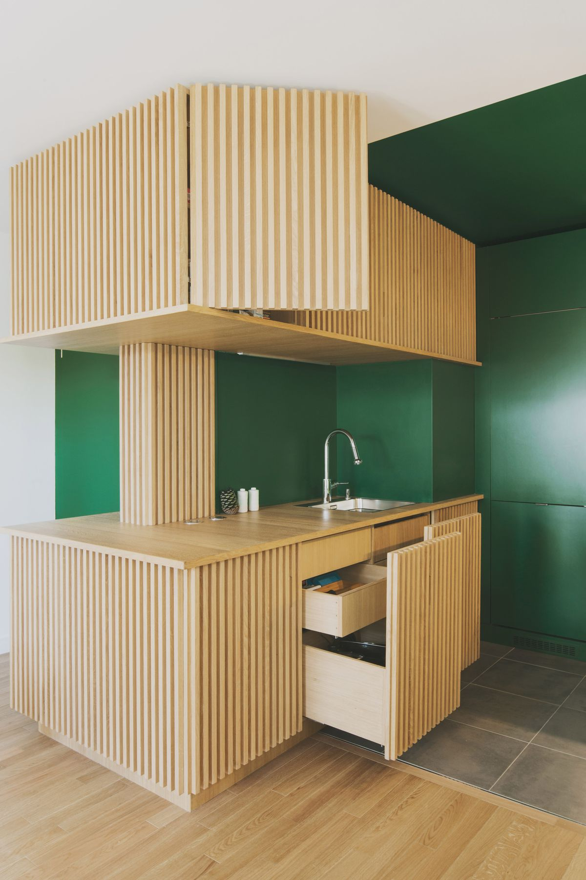 Green kitchen with birch wood countertops