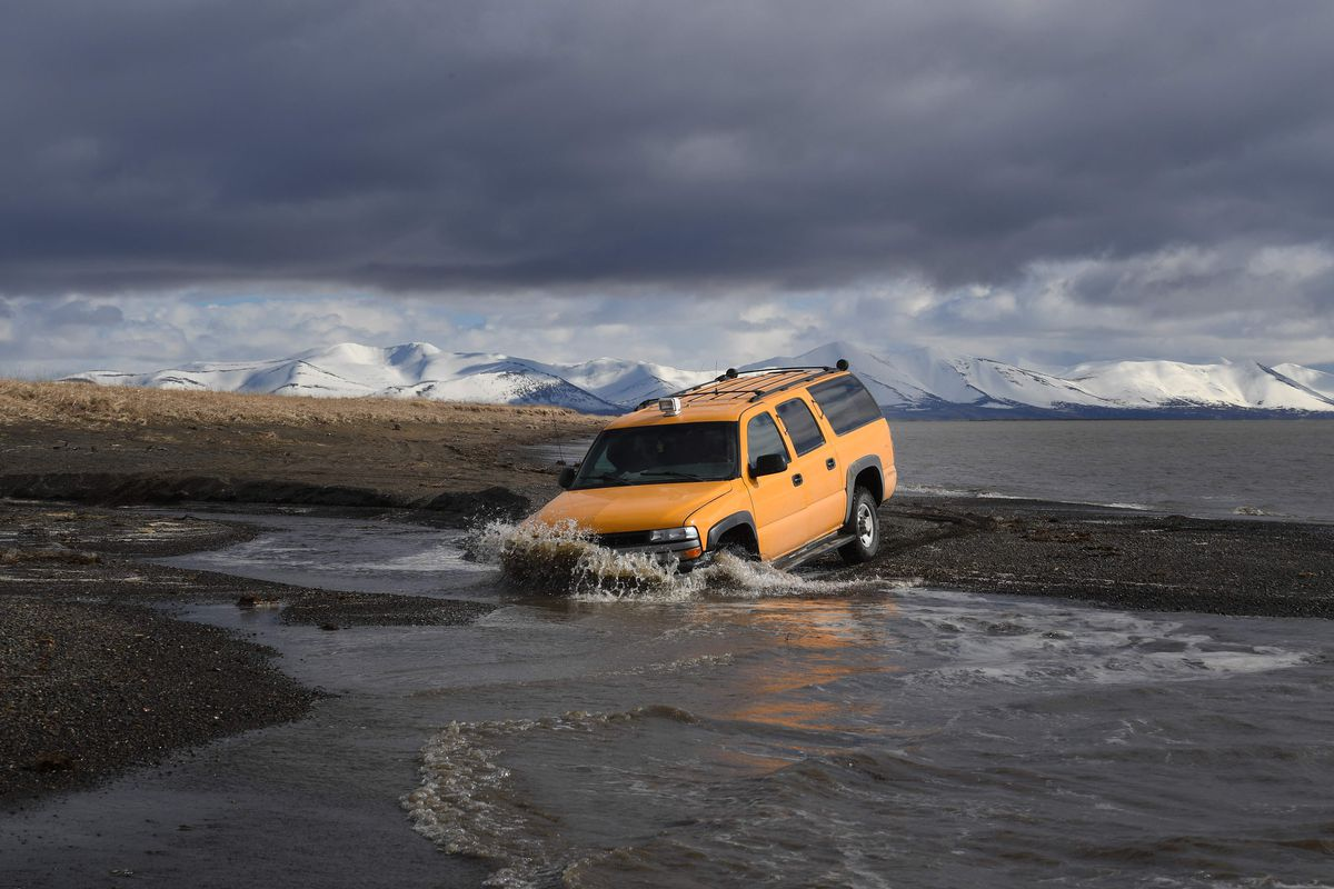 A vehicle drives beside the melting permafrost tundra on the edge of the Bering Sea at the town of Quinhagak on the Yukon Delta in Alaska on April 12, 2019. - According to scientists, Alaska has been warming twice as fast as the global average, with tempe