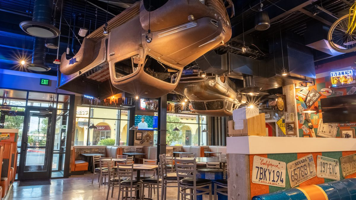 A truck hangs from the ceiling of a restaurant