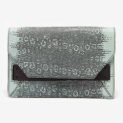 "<span class=""credit""><b>10 Crosby Derek Lam</b> Lizard Print Leather Folio Clutch at <b>Intermix</b>, <a href=""http://www.intermixonline.com/product/10+crosby+derek+lam+lizard+print+leather+folio+clutch.do?sortby=ourPicks&CurrentCat=109500"">$395</a></span"