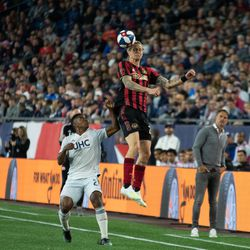 FOXBOROUGH, MA - APRIL 13: Atlanta United FC defender Brek Shea #20 heads the ball during the first half against the New England Revolution at Gillette Stadium on April 13, 2019 in Foxborough, Massachusetts. (Photo by J. Alexander Dolan - The Bent Musket)