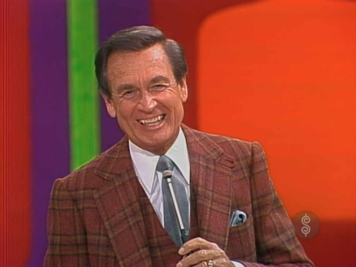 Bob Barker in a flannel red suit hosting Price Is Right in the 1980s