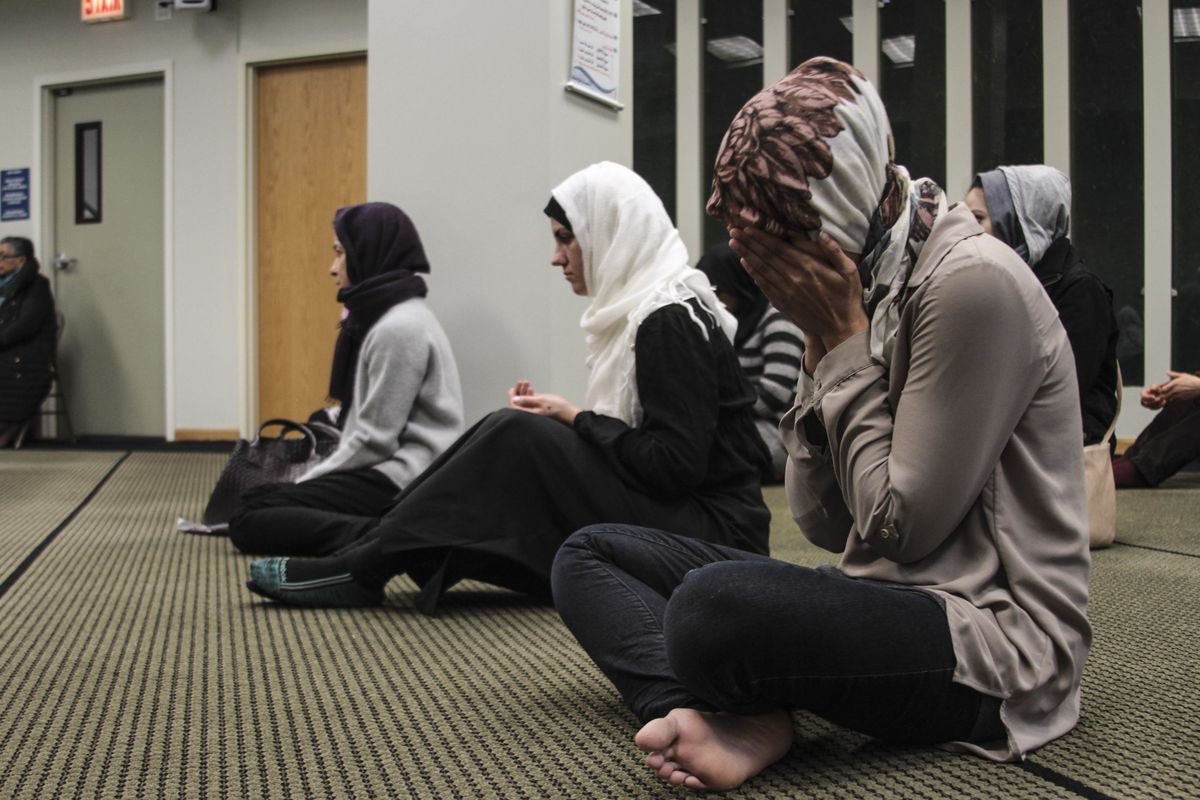 Muslim women pray at the Council of Islamic Organizations headquarters in 2017.