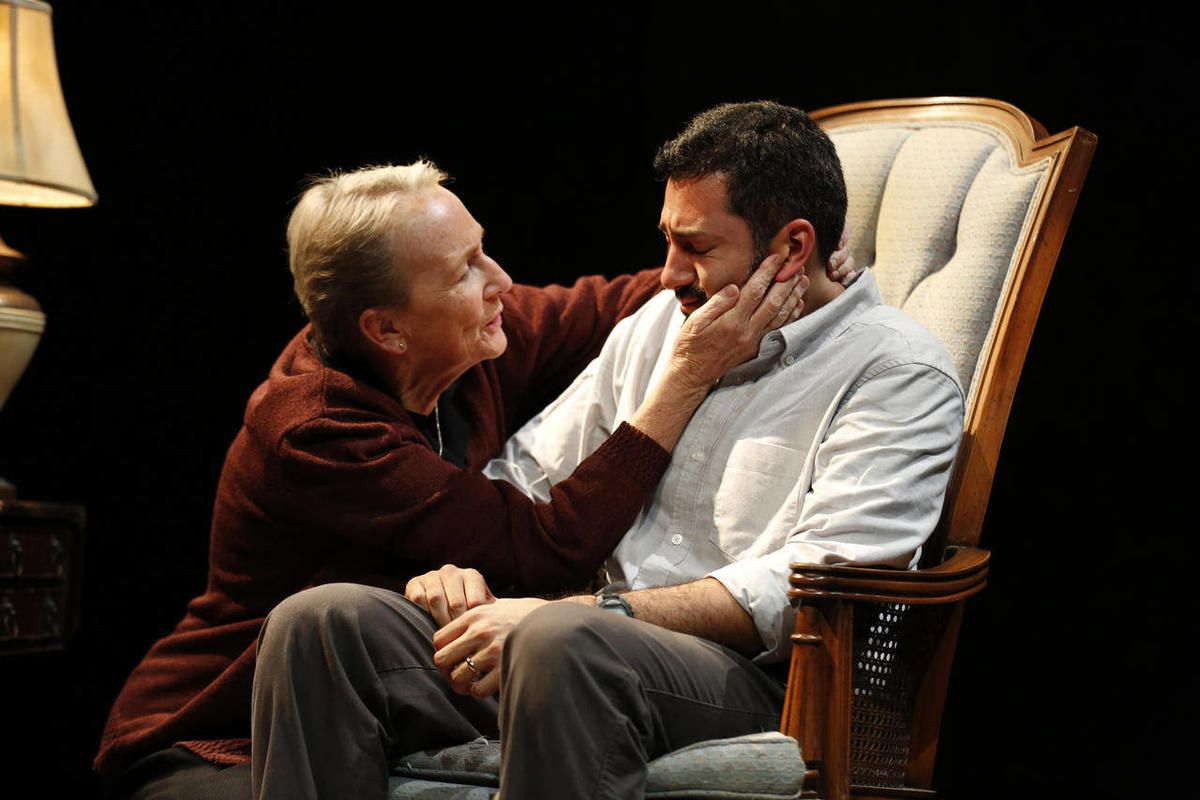 """This theater image released by Richard Kornberg & Associates shows Kathleen Chalfant, left, and Alfredo Narciso in a scene from """"Red Dog Howls,"""" performing off-Broadway at New York Theatre Workshop in New York."""