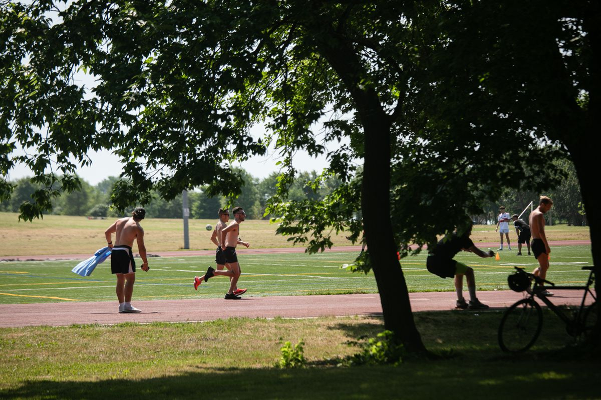 People exercise on the Montrose Lakefront Track in Uptown Saturday morning.