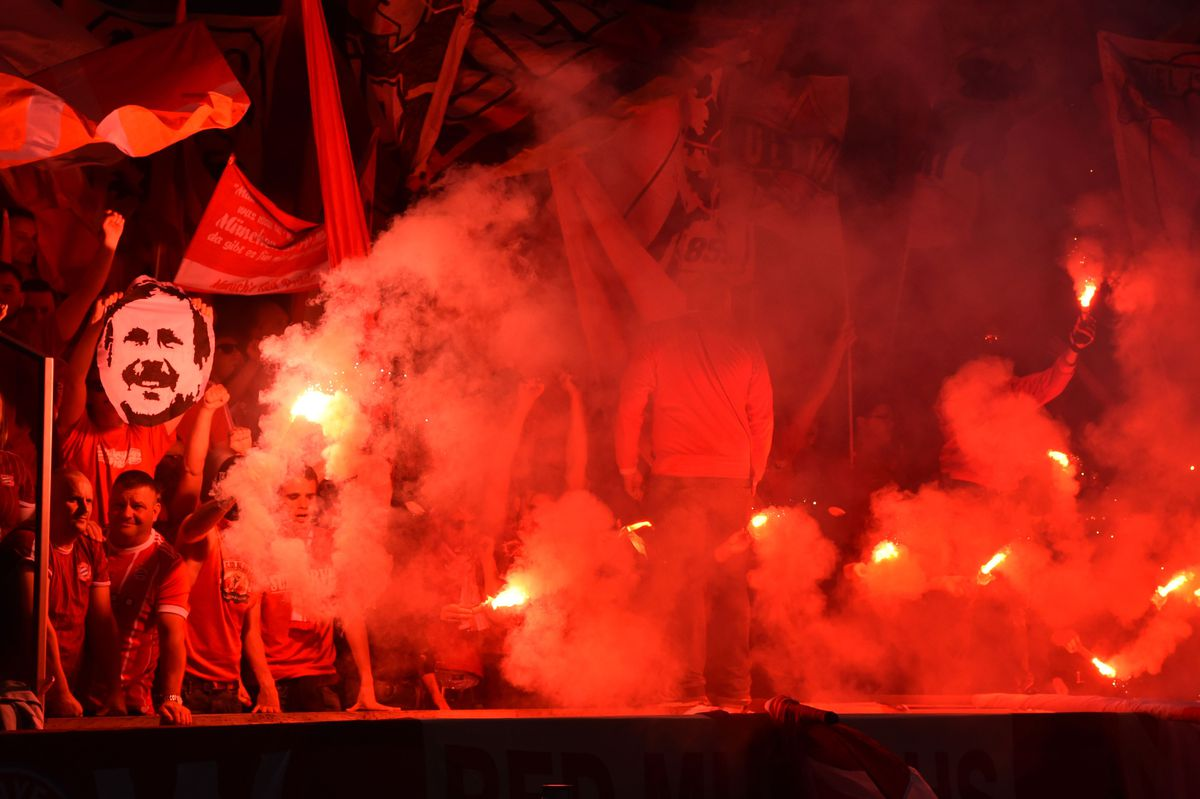 Fans light flares during the German Cup DFB Pokal final football match FC Bayern Munich vs Eintracht Frankfurt at the Olympic Stadium in Berlin on May 19, 2018.