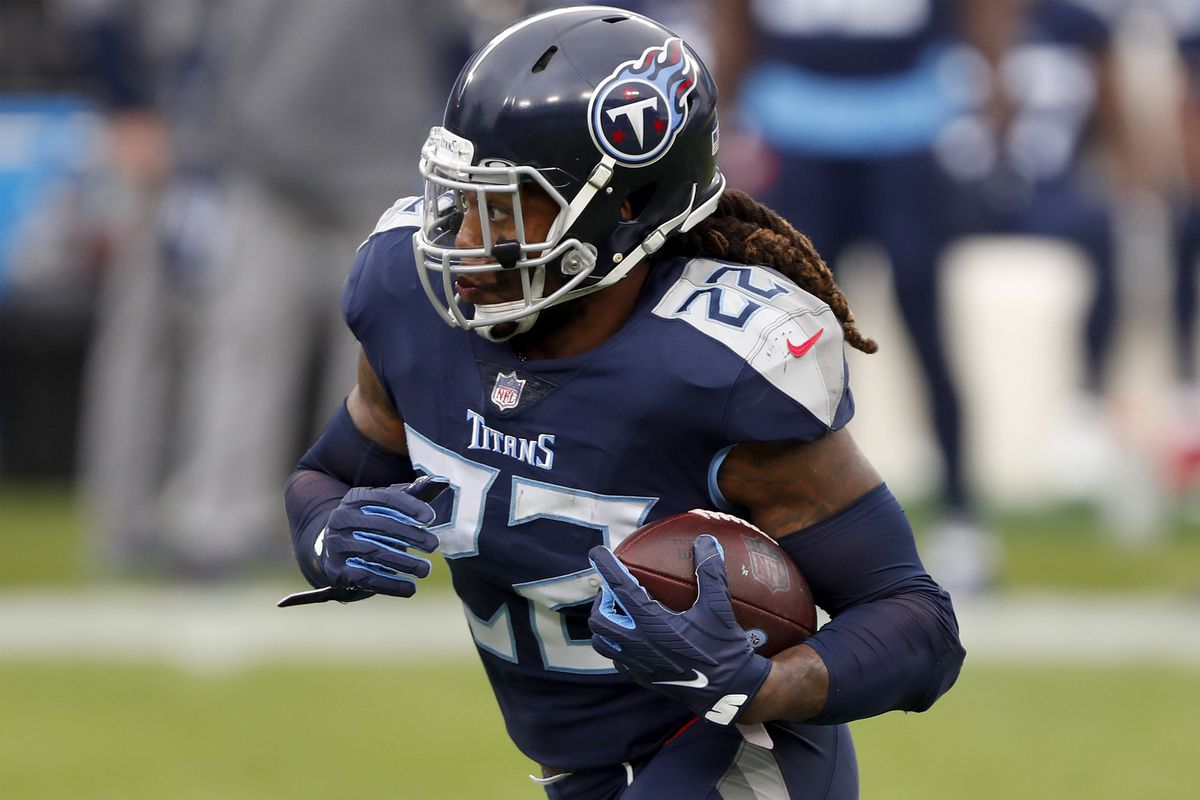 Running back Derrick Henry #22 of the Tennessee Titans caries the football against the defense of the Detroit Lions during the first quarter of the game at Nissan Stadium on December 20, 2020 in Nashville, Tennessee.