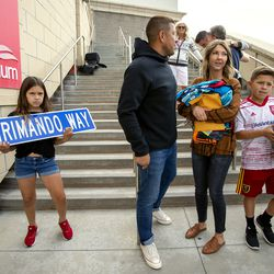 Real Salt Lake's goalkeeper Nick Rimando, second from left, is joined by his kids Benny Rose Rimando, left, and Jett Nicholas Rimando and girlfriend Randi Petersen at Rio Tinto Stadium in Sandy on Friday, Sept. 27, 2019, where a street was renamed Rimando Way. Rimando will play his last home game on Sunday.