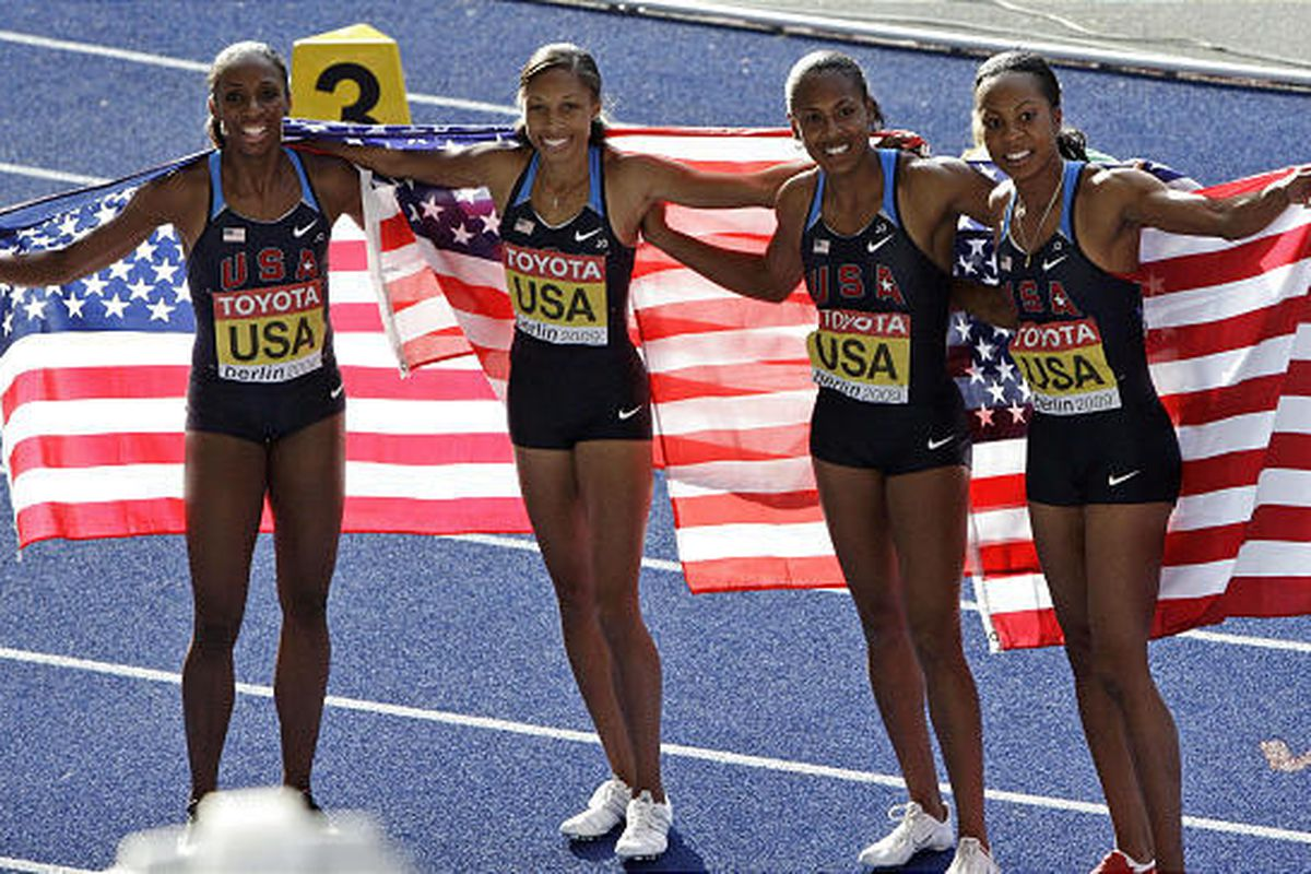 Lashinda Demus, Allyson Felix, Debbie Dunn and Sanya Richards of the United States, from left, celebrate after winning the gold medal in the final of the Women's 4x400m relay during the World Athletics Championships in Berlin on Sunday.