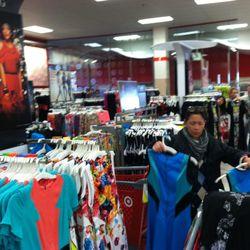 A shopper examining the still-packed racks at Target WeHo.