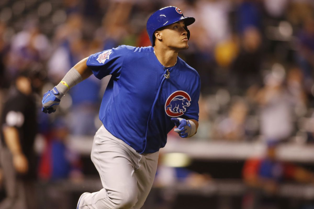 Javier Baez admiring his first of many bombs