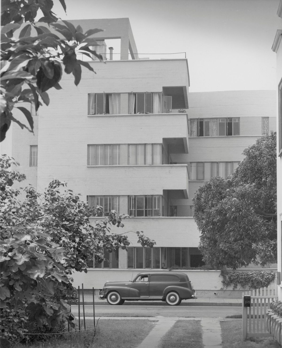 A black and white photo of the four-story landmarked apartment building.