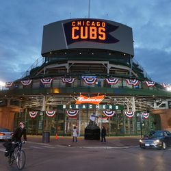 FOX Sports had their stage lights on, illuminating the bleacher gate, at Waveland and Sheffield