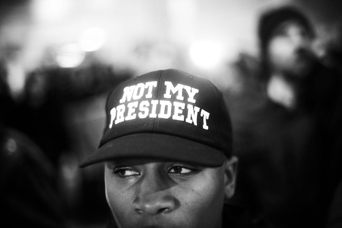 A protestor demonstrates before the inauguration of Donald Trump as the 45th President of the United States, on January 20, 2017.