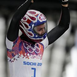 Noelle Pikus-Pace of the United States waves to supporters in the finish area after her first run during the women's skeleton competition at the 2014 Winter Olympics, Thursday, Feb. 13, 2014, in Krasnaya Polyana, Russia. (AP Photo/Natacha Pisarenko)