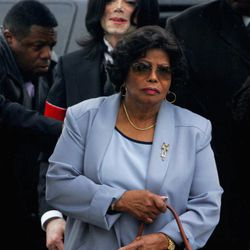 FILE - In this Monday, Feb. 28, 2005 file photo, Michael Jackson follows his mother, Katherine Jackson, as they arrive for court on the opening day of his child molestation trial at Santa Barbara County Superior Court in Santa Maria, Calif. A trial scheduled to begin Tuesday September 6, 2012 will determine how much a businessman working with Katherine Jackson will have to pay her son's estate for infringing some of its copyrights.