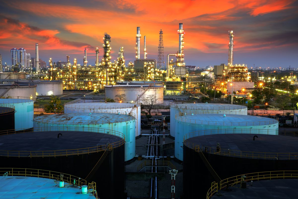 Landscape of oil refinery industry with oil storage tank.