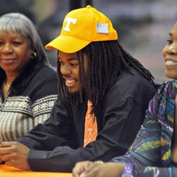 Clarke Central's Queshaun Watson sits with his grandmother, Elenor Watson, left, and mother, Fashonna Maxwell, before signing a letter of intent to attend the University of Tennessee during a national signing day ceremony at Clarke Central High School on Wednesday, Feb. 1, 2012 in Athens, Ga.