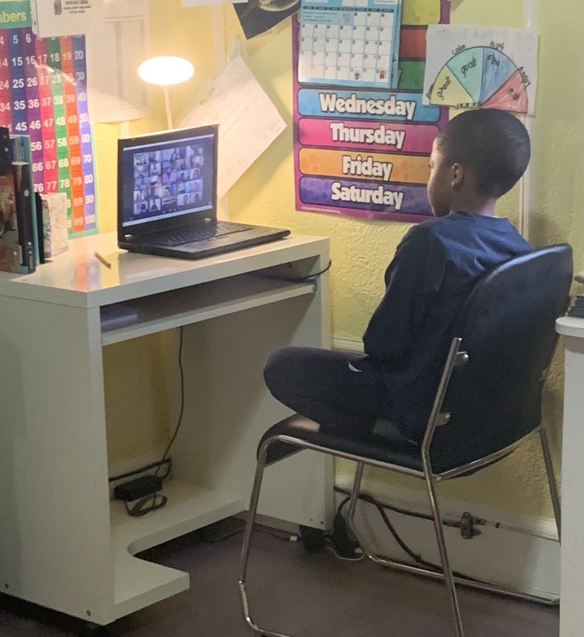 Melinda Edwards' son Dillon works during a remote class at home.