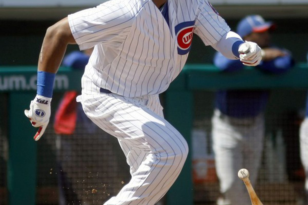 Mesa, AZ, USA; Chicago Cubs shortstop Starlin Castro triples in the first inning against the Texas Rangers at HoHoKam Park.  Mandatory Credit: Rick Scuteri-US PRESSWIRE