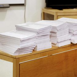 Copies of the second report, of some 300 pages, regarding the mental health of Anders Behring Breivik, are stacked onto a table inside the court in Oslo, Norway, Tuesday, April 10, 2012.  According to the new psychiatric assessment report, the right-wing extremist, Anders Breivik, who confessed to killing 77 people in a bomb and shooting rampage in Norway on July 22, 2011, is not criminally insane,  contradicting an earlier assessment.