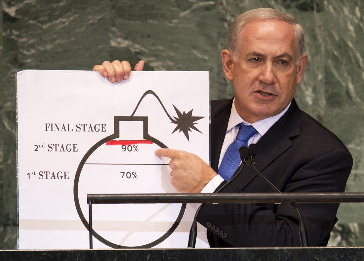 Israeli Prime Minister Benjamin Netanyahu holds a diagram of a bomb to demonstrate Iran's nuclear program at the 2012 UN General Assembly (DON EMMERT/AFP/Getty)
