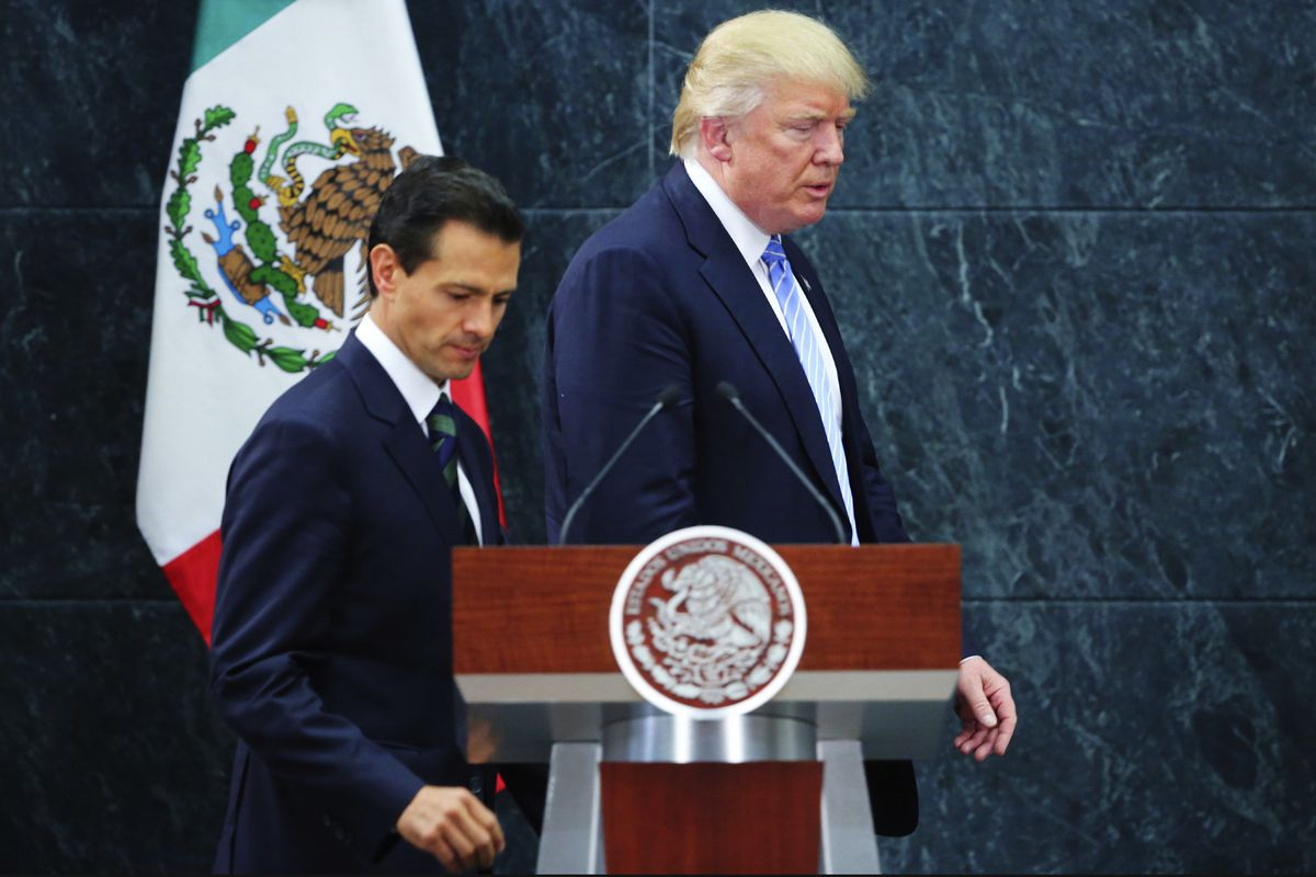 President of Mexico Enrique Pena Nieto walks along US Republican presidential candidate Donald Trump after a meeting at Los Pinos on August 31, 2016 in Mexico City, Mexico.