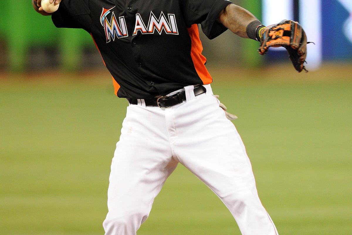 July 13, 2012; Miami, FL, USA; Miami Marlins third baseman Hanley Ramirez (2) warms up during infield practice before a game against the Washington Nationals at Marlins Park. Mandatory Credit: Steve Mitchell-US PRESSWIRE