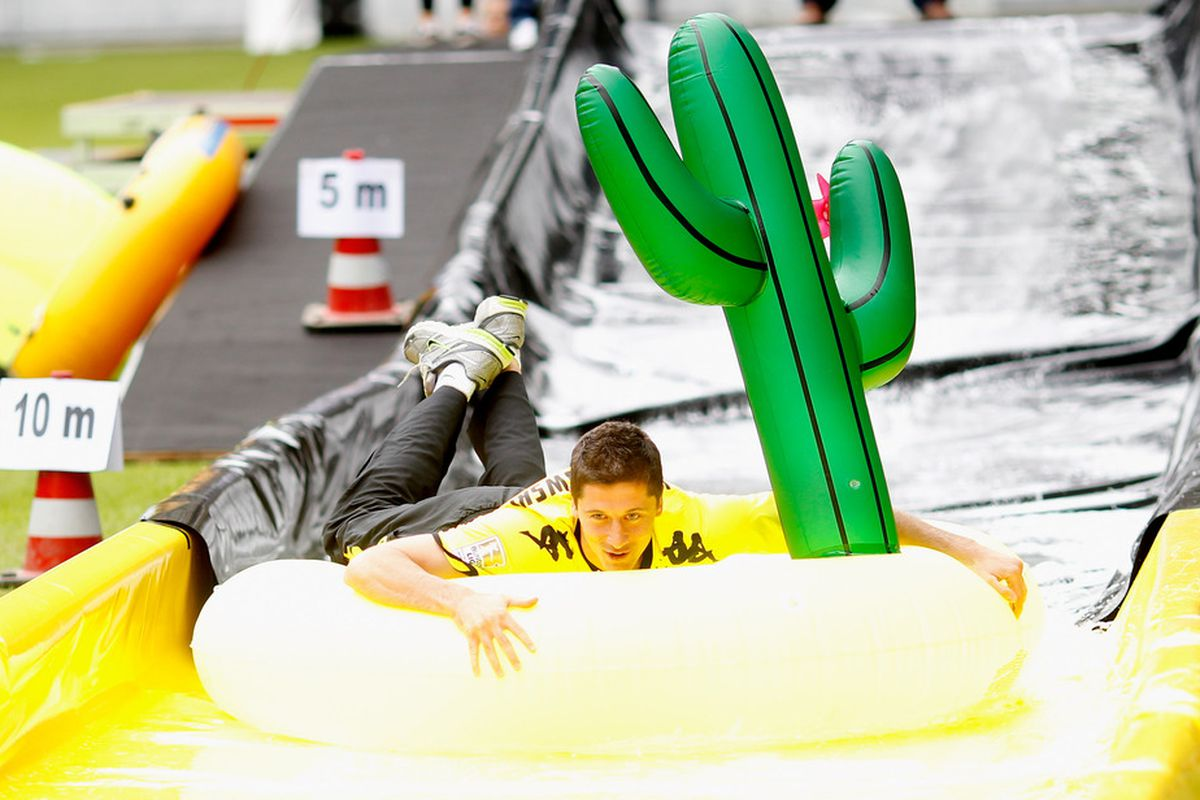 I have no idea what is going on here, but a picture of Robert Lewandowski going down a water slide with an inflatable cactus seemed like an accurate way to describe my feelings for the Polish striker. (Photo by Friedemann Vogel/Bongarts/Getty Images)