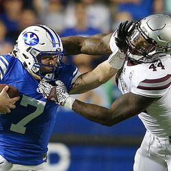 Brigham Young Cougars quarterback Taysom Hill (7) tries to fight off Mississippi State Bulldogs linebacker Leo Lewis (44) on a run downfield as BYU and Mississippi State play in Provo at LaVell Edwards Stadium on Friday, Oct. 14, 2016.
