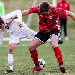 Wasatch's Carter Davis and Springville's Hondo Quezada compete for the ball during a boys soccer game in Springville on Tuesday, March 23, 2021.