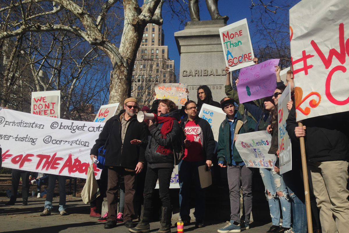 Sarah Quinter, an artist and educator who graduated from City-As-School in 2004, speaks to demonstrators gathered at Washington Square Park to protest Gov. Cuomo's proposed education policy changes.
