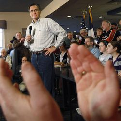 Republican presidential candidate, former Massachusetts Gov. Mitt Romney talks to supporters at the Family Table restaurant during a campaign stop, Saturday, Dec. 31, 2011, in Le Mars, Iowa.