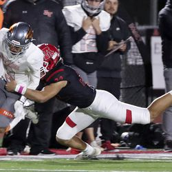 Skyridge's Smith Snowden gets tackled by American Fork's Nicholas Lavulavu during a varsity football game at American Fork High School in American Fork on Wednesday, Oct. 13, 2021. Skyridge won 42-22.