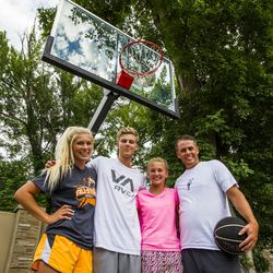 Kurt Christensen is pictured with his children McCall, 18, left, Adam, 15, and Elle, 13, at their home in Cottonwood Heights on Wednesday, Aug. 12, 2015.