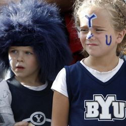 Young BYU fans Elijah and his sister Julia Simon watch some of the tailgating festivities before the game as BYU and Utah get set to play Saturday, Sept. 17, 2011 at Lavell Edwards Stadium.