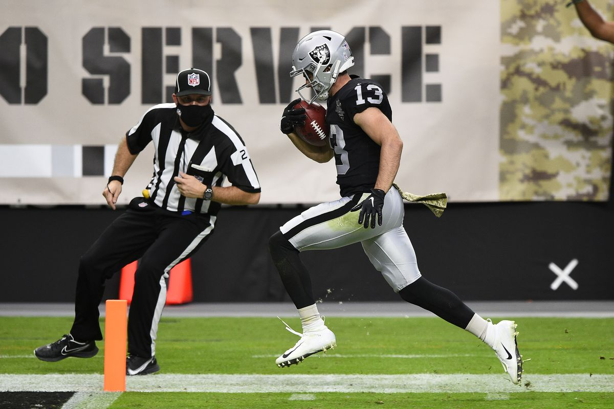 Wide receiver Hunter Renfrow #13 of the Las Vegas Raiders runs into the end zone during a punt return against the Denver Broncos in the first half of their game at Allegiant Stadium on November 15, 2020 in Las Vegas, Nevada. The play was called back on a penalty against the Raiders.