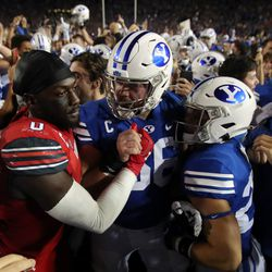 Utah Utes linebacker Devin Lloyd (0) and Brigham Young Cougars offensive lineman James Empey (66) greet each other after the game as BYU defeats Utah in an NCAA football game at LaVell Edwards Stadium in Provo on Saturday, Sept. 11, 2021. BYU won 26-17, ending a nine-game losing streak to the Utes.