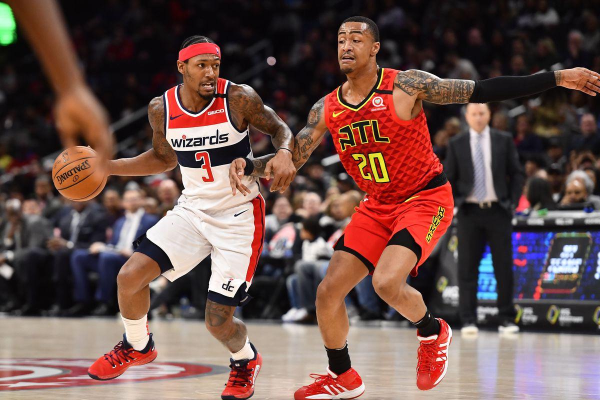 Washington Wizards guard Bradley Beal dribbles against Atlanta Hawks forward John Collins during the second half at Capital One Arena.