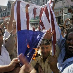 """Kashmiri Muslims burn a mock American flag during a protest against an anti-Islam film called """"Innocence of Muslims"""" that ridicules Islam's Prophet Muhammad, in Srinagar, India, Friday, Sept. 14, 2012."""