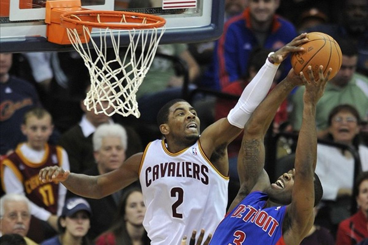 Feb 121, 2012; Cleveland, OH, USA; Cleveland Cavaliers point guard Kyrie Irving (2) attempts to block a shot by Detroit Pistons point guard Rodney Stuckey (3)  in the fourth quarter at Quicken Loans Arena. Mandatory Credit: David Richard-US PRESSWIRE