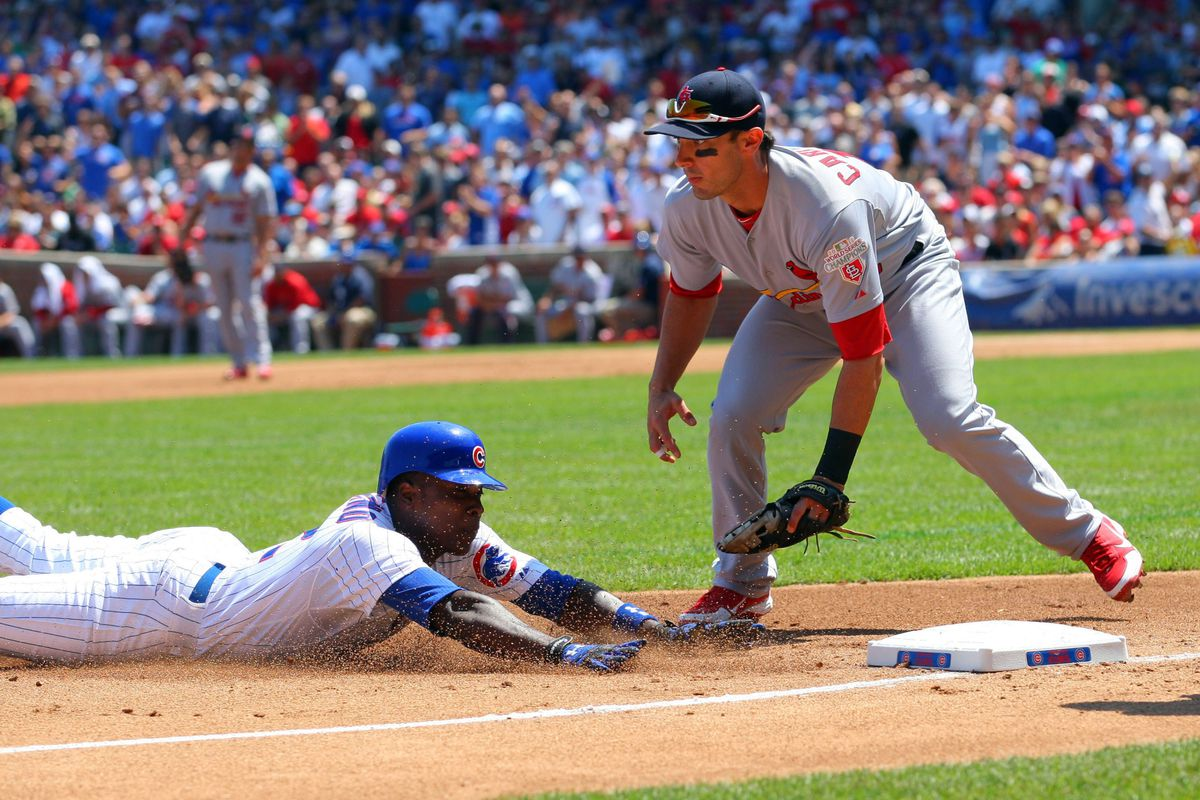 Chicago, IL, USA; Chicago Cubs left fielder Alfonso Soriano slides safely into third base with a triple as St. Louis Cardinals third baseman Matt Carpenter takes the throw at Wrigley Field. Credit: Dennis Wierzbicki-US PRESSWIRE