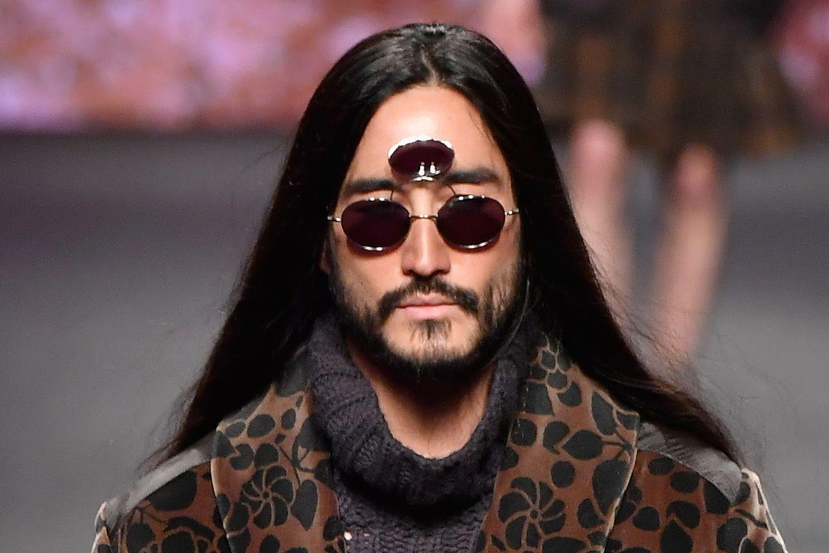Model wearing three-lens sunglasses on Etro runway in Milan