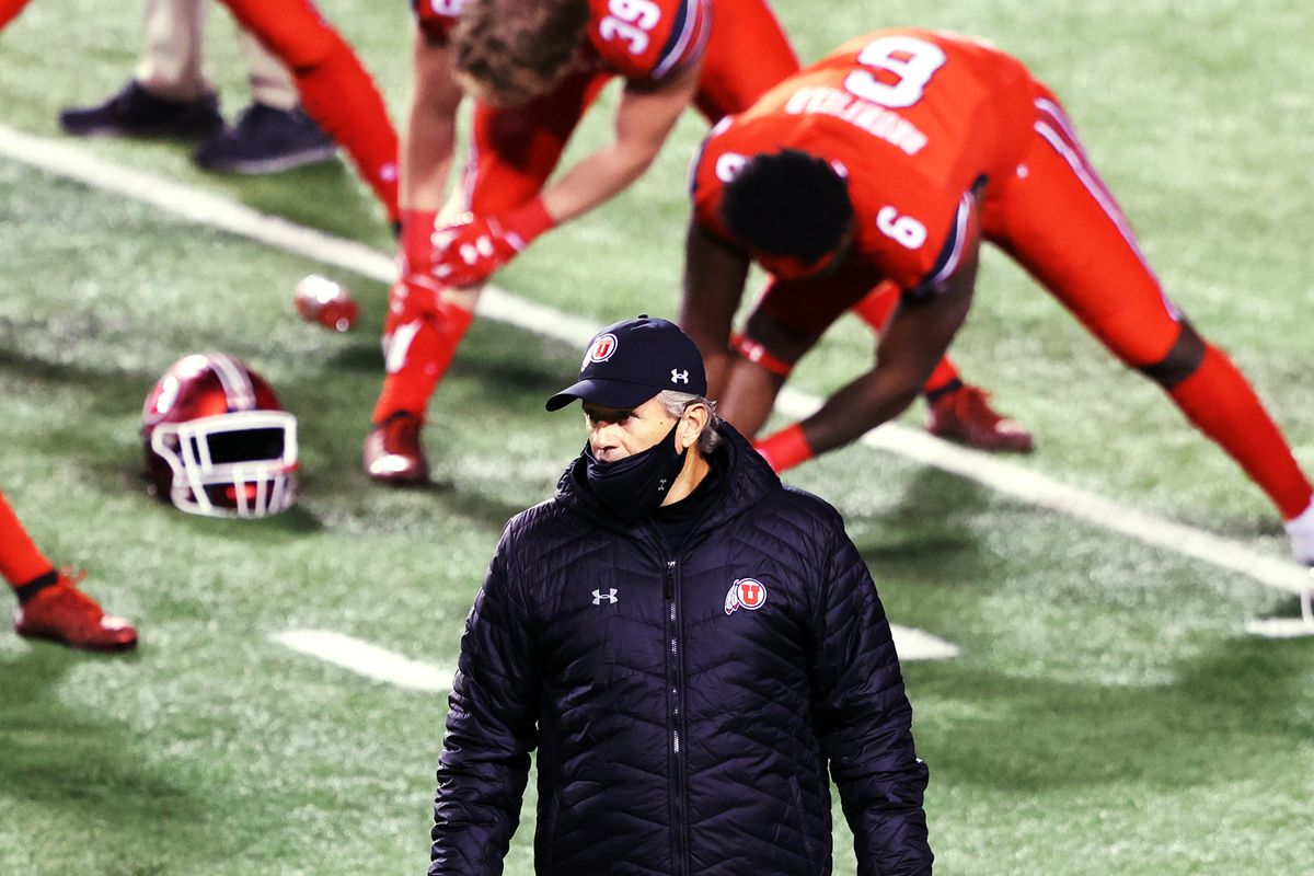 Utah Utes head coach Kyle Whittingham walks around his players as they begin their warmups as Utah and Oregon State prepare to play a college football game at Rice-Eccles Stadium in Salt Lake City on Saturday, Dec. 5, 2020.