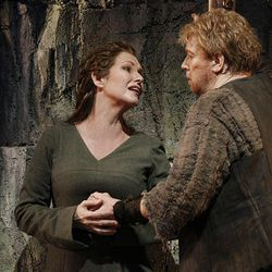 """Janice Baird as Brunnhilde, left, and Stig Andersen as Siegfried are shown during a performance of """"Siegfried,"""" at Marion Oliver McCaw Hall in Seattle."""