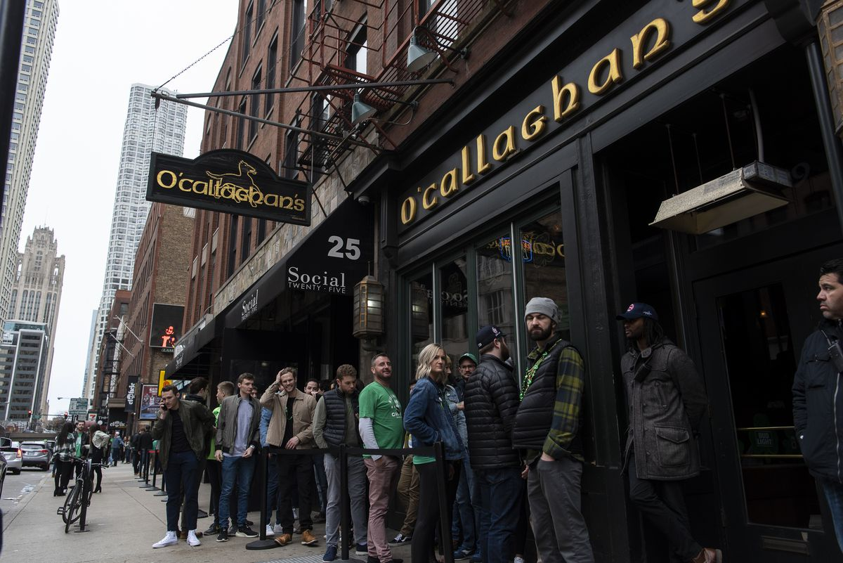 People line up outside a River North Bar in March 2020, before the COVID-19 shutdown.