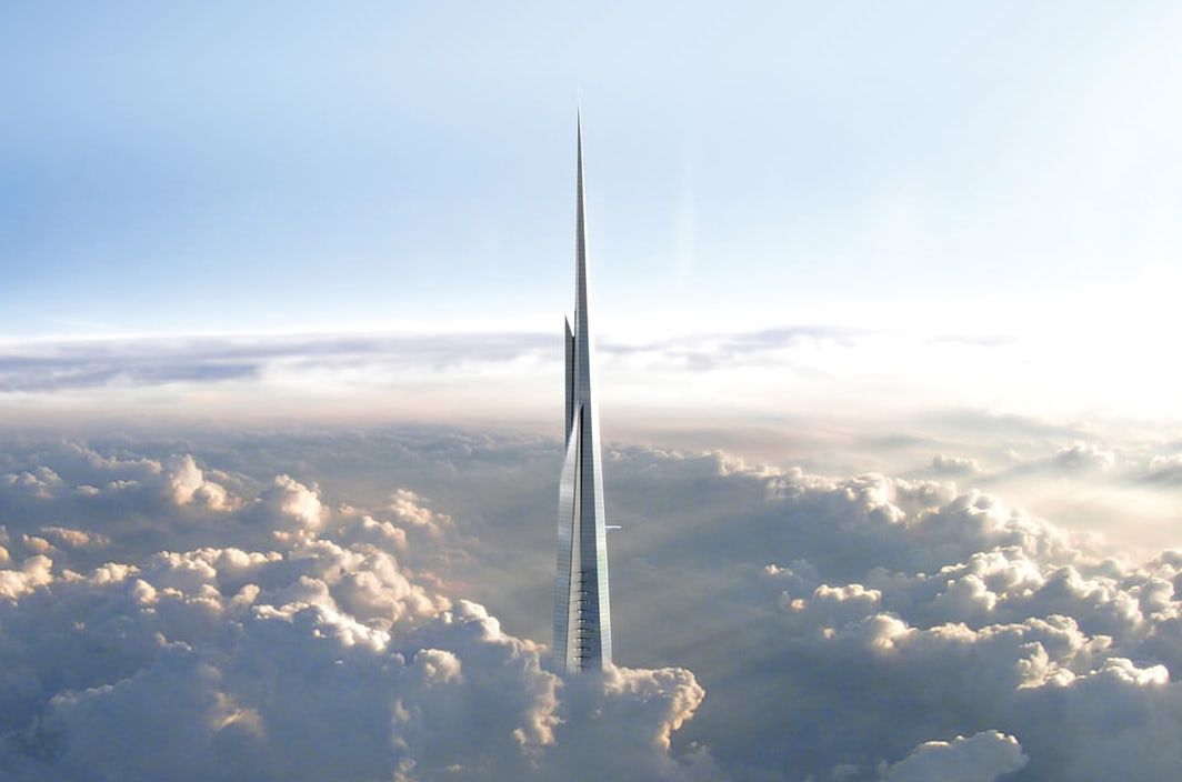 The top of the Jeddah Tower surrounded by clouds.
