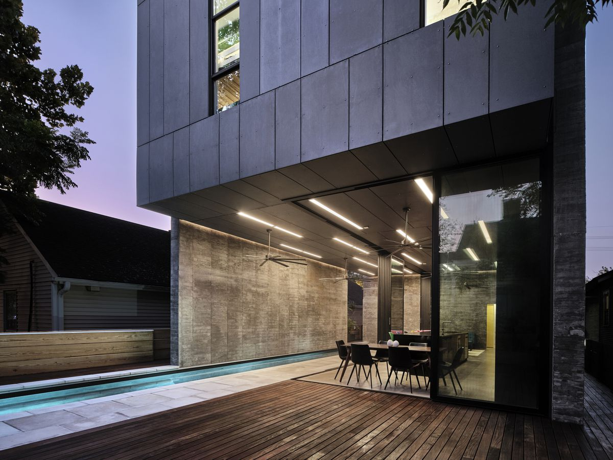 Back deck featuring narrow swimming pool.