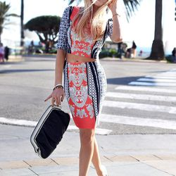 """Shea of <a href=""""http://peaceloveshea.com/"""">Peace Love Shea</a> is wearing a top and skirt by <a href=""""http://www.revolveclothing.com/DisplayProduct.jsp?product=CLOV-WQ7"""">Clover Canyon</a>, Prada sunglasses, <a href=""""http://www.shoemint.com/shoes/lulu/"""">S"""